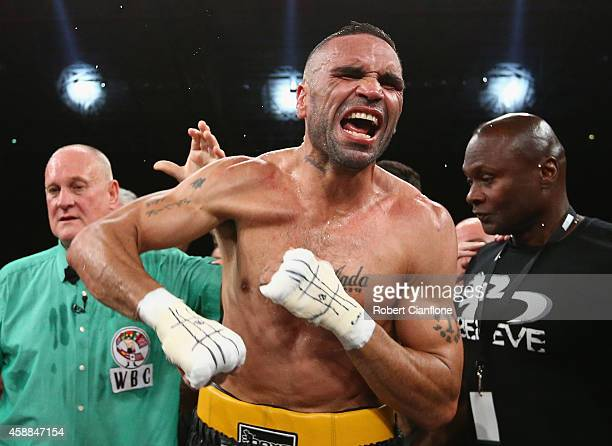 Anthony Mundine of Australia celebrates after defeating Sergey Rabchenko of Belarus during the WBC Silver Light Middleweight fight at Hisense Arena...