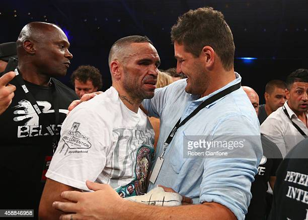 Anthony Mundine of Australia celebrates with Brendan Fevola after defeating Sergey Rabchenko of Belarus during the WBC Silver Light Middleweight...