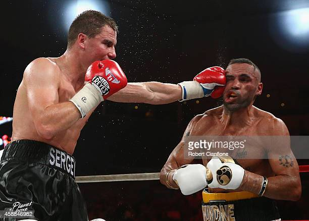 Anthony Mundine of Australia fights Sergey Rabchenko of Belarus during the WBC Silver Light Middleweight fight at Hisense Arena on November 12 2014...