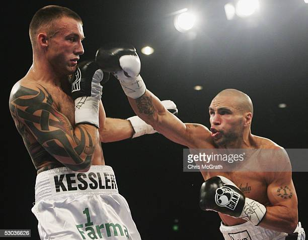 Anthony Mundine of Australia in action against Mikkel Kessler of Denmark during the WBA super middleweight title fight between Anthony Mundine of...