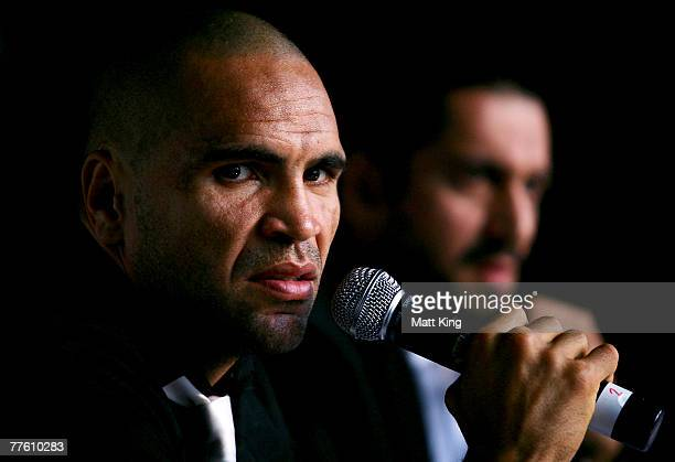 Anthony Mundine speaks to the media as his manager Khoder Nasser looks on at a press conference held to announce the next bout in his World Title...