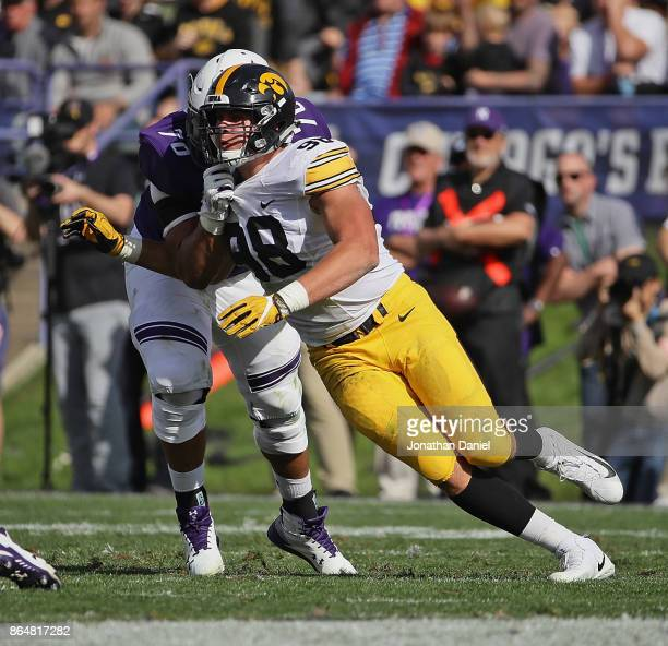 Anthony Nelson of the Iowa Hawkeyes rushes against Rashawn Slater of the Northwestern Wildcats at Ryan Field on October 21, 2017 in Evanston,...