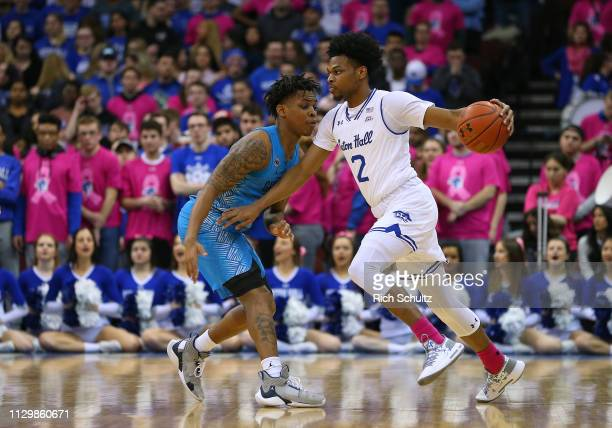 Anthony Nelson of the Seton Hall Pirates in action against James Akinjo of the Georgetown Hoyas during a game at Prudential Center on February 13...