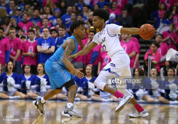 Anthony Nelson of the Seton Hall Pirates James Akinjo during a game at Prudential Center on February 13 2019 in Newark New Jersey Seton Hall defeated...