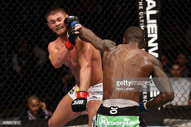 Anthony Njokuani punches Daron Cruickshank in their lightweight bout at the Scotiabank Centre on October 4 2014 in Halifax Nova Scotia Canada