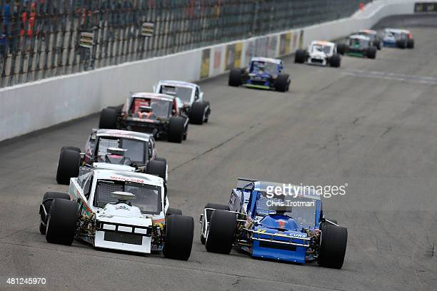 Anthony Nocella driver of the Nocella Reclamation/Fast Track Chevrolet and Gary Putnam driver of the Curb Records Chevrolet lead a pack of cars...