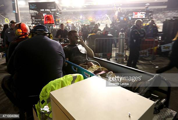 Anthony O'Brien a rear tire changer for Brendan Gaughan driver of the South Point Chevrolet receives medical attention following a fire on pit road...