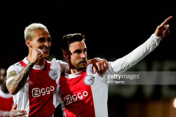 Anthony of Ajax and Nico Tagliafico of Ajax celebrate their sides fifth goal during the Dutch Eredivisie match between Fortuna Sittard and Ajax at...