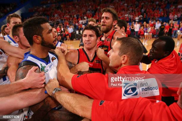 Anthony of the 36ers remonstrates with Wildcats assistant coach Adam Tatalovich after a post game melee during the round 18 NBL match between the...