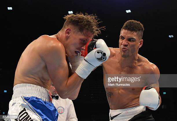 Anthony Ogogo and Gary Cooper during an undercard bout ahead of the WBA world superlightweight title fight between Ricky Burns and Michele Di Rocco...