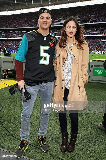 Anthony Ogogo and Lucy Watson attend the annual NFL International Series as the Jacksonville Jaguars compete against the Buffalo Bills at Wembley...
