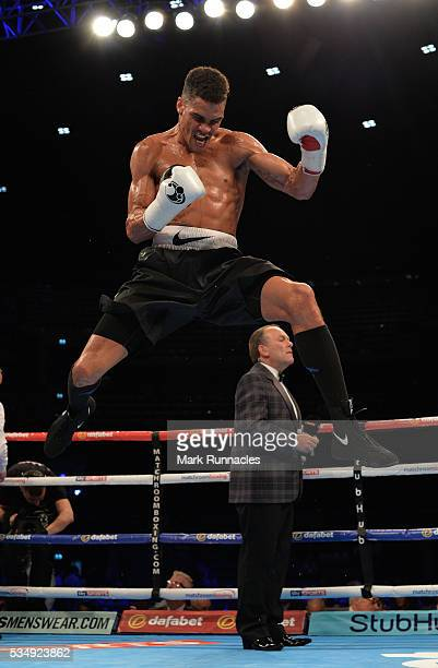 Anthony Ogogo celebrates after beating Gary Cooper during an undercard bout ahead of the WBA world superlightweight title fight between Ricky Burns...