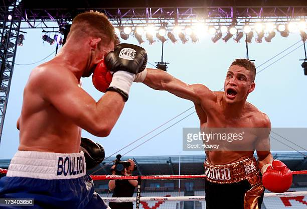 Anthony Ogogo connects with Gary Boulden during their Middleweight bout at Craven Park Stadium on July 13 2013 in Hull England