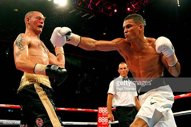 Anthony Ogogo in action with Wayne Reed during their Middleweight contest fight at the Liverpool Echo Arena on July 12 2014 in Liverpool England