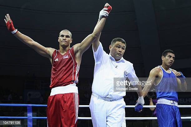 Anthony Ogogo of England acknowledges his victory against Andrew Kometa of Kiribati in the Middle 75kg category at the Talkatora Indoor Stadium...