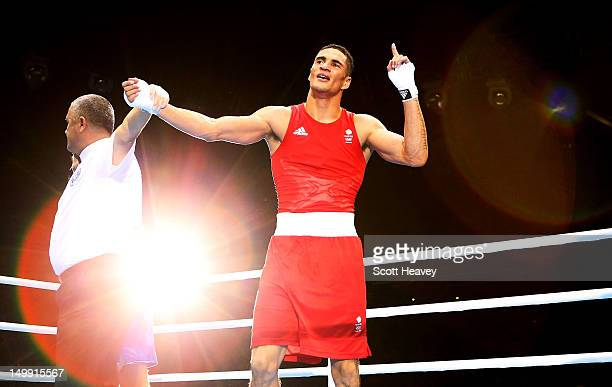 Anthony Ogogo of Great Britain celebrates his victory over Stefan Hartel of Germany during the Men's Middle Boxing on Day 10 of the London 2012...