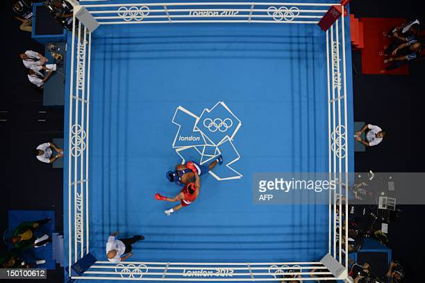 Anthony Ogogo of Great Britain defends against Esquiva Falcao Florentino of Brazil during the men's Middleweight boxing semifinals of the 2012 London...