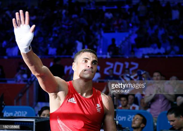 Anthony Ogogo of Great Britain departs the ring following his loss to Esquiva Falcao Florentino of Brazil in the men's Middleweight boxing semifinals...
