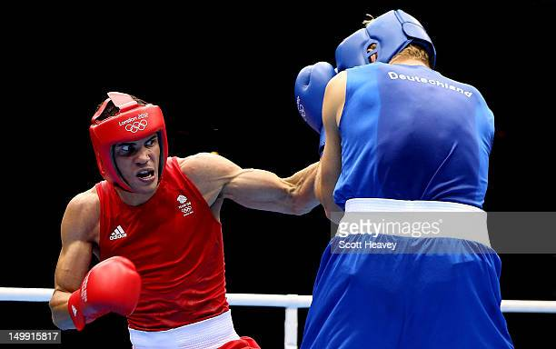 Anthony Ogogo of Great Britain in action with Stefan Hartel of Germany during the Men's Middle Boxing on Day 10 of the London 2012 Olympic Games at...