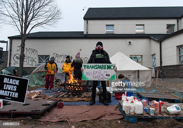 Anthony Osman center holds a sign outside the 4th police precinct November 20 2015 in Minneapolis Minnesota Activists are keeping up pressure for...