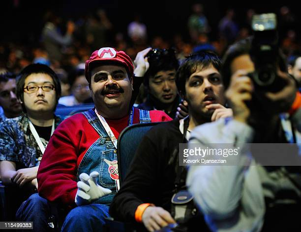 Anthony Parisi a photographer for 1UPcom from New York City attends the unveiling of the new game console Wii U dressed as the Nintendo game...