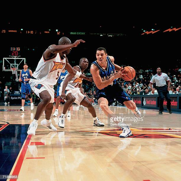 Anthony Parker of the Orlando Magic drives to the basket against the Golden State Warriors during a game played January 17 2000 at the Arena in...