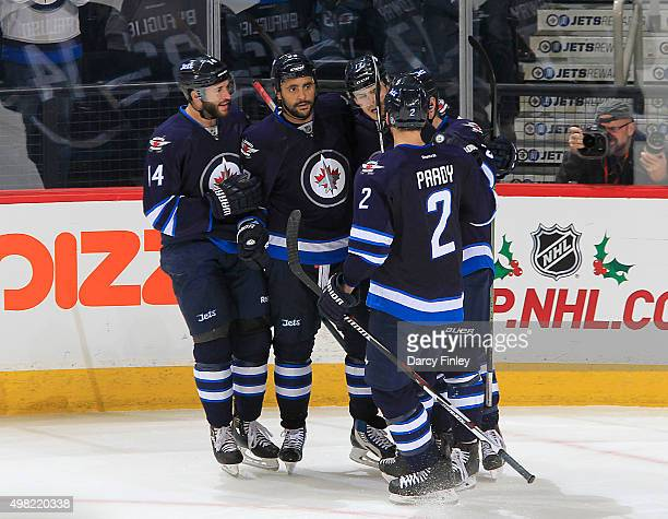 Anthony Peluso Dustin Byfuglien Adam Lowry Adam Pardy and Andrew Copp of the Winnipeg Jets celebrate Byfuglien's second period goal against the...