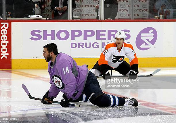 Anthony Peluso of the Winnipeg Jets and Brayden Schenn of the Philadelphia Flyers take part in the pregame warm up prior to NHL action at the MTS...