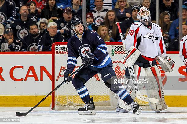 Anthony Peluso of the Winnipeg Jets and goaltender Braden Holtby of the Washington Capitals keep an eye on the play during third period action at the...