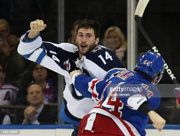 Anthony Peluso of the Winnipeg Jets and Justin Falk of the New York Rangers fight during the first period at Madison Square Garden on December 2 2013...