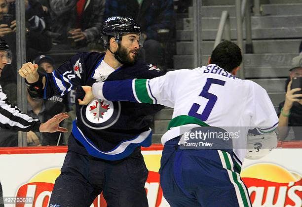 Anthony Peluso of the Winnipeg Jets and Luca Sbisa of the Vancouver Canucks engage in a first period fight at the MTS Centre on November 18 2015 in...
