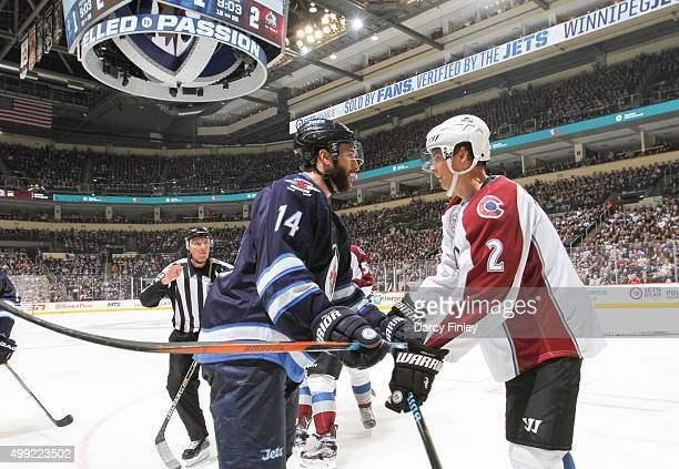 Anthony Peluso of the Winnipeg Jets and Nick Holden of the Colorado Avalanche mix it up during thirdperiod action at the MTS Centre on November 23...