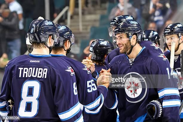 Anthony Peluso of the Winnipeg Jets celebrates a 61 victory over the Toronto Maple Leafs with teammates Jacob Trouba and Mark Scheifele at the MTS...