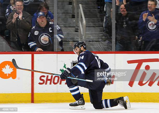 Anthony Peluso of the Winnipeg Jets celebrates after scoring his first goal of the season during third period action against the Toronto Maple Leafs...