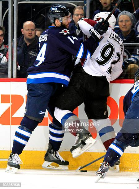 Anthony Peluso of the Winnipeg Jets collides with Gabriel Landeskog of the Colorado Avalanche along the boards during first period action at the MTS...
