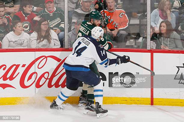 Anthony Peluso of the Winnipeg Jets defends Marco Scandella of the Minnesota Wild during the game on January 15 2016 at the Xcel Energy Center in St...