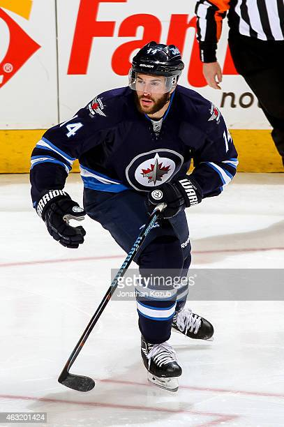 Anthony Peluso of the Winnipeg Jets follows the play down the ice during third period action against the Chicago Blackhawks on February 6 2015 at the...