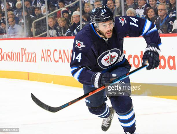 Anthony Peluso of the Winnipeg Jets follows the play down the ice during first period action against the Los Angeles Kings at the MTS Centre on...