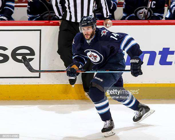 Anthony Peluso of the Winnipeg Jets follows the play down the ice during third period action against the St Louis Blues at the MTS Centre on December...