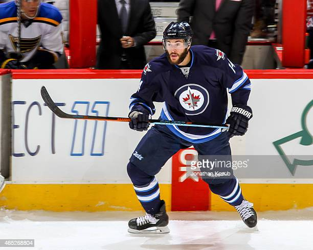 Anthony Peluso of the Winnipeg Jets follows the play up the ice during third period action against the St Louis Blues on February 26 2015 at the MTS...