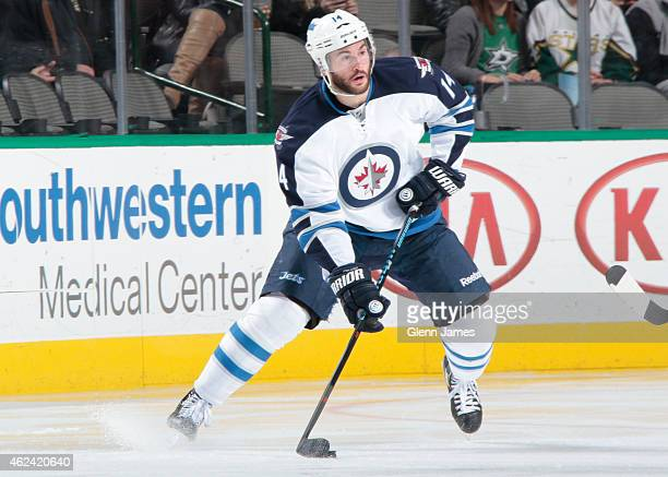 Anthony Peluso of the Winnipeg Jets handles the puck against the Dallas Stars at the American Airlines Center on January 15 2015 in Dallas Texas