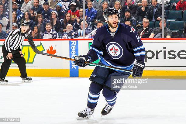 Anthony Peluso of the Winnipeg Jets keeps an eye on the play during third period against the Florida Panthers on January 13 2015 at the MTS Centre in...