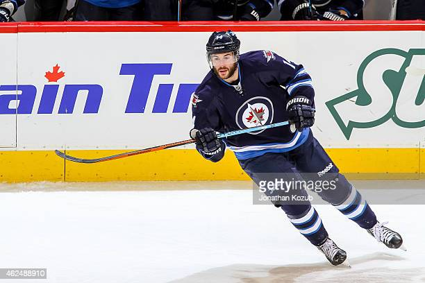 Anthony Peluso of the Winnipeg Jets keeps an eye on the play during third period action against the Columbus Blue Jackets on January 21 2015 at the...