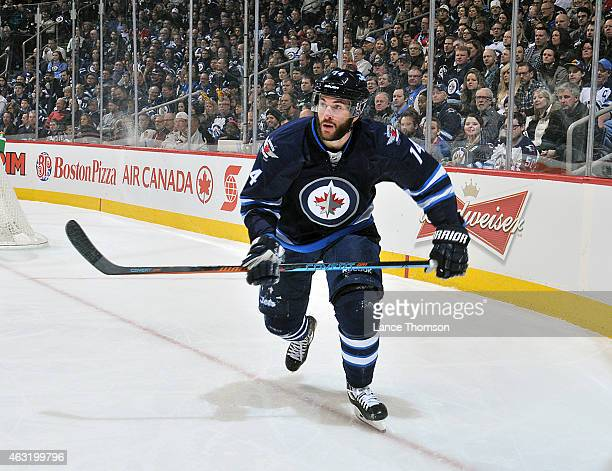 Anthony Peluso of the Winnipeg Jets keeps an eye on the play during first period action against the Chicago Blackhawks on February 6 2015 at the MTS...