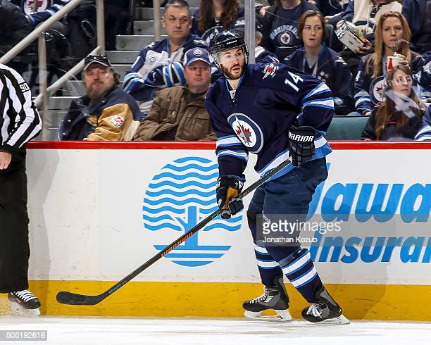 Anthony Peluso of the Winnipeg Jets keeps an eye on the play during second period action against the Buffalo Sabres at the MTS Centre on January 10...