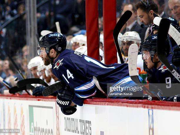 Anthony Peluso of the Winnipeg Jets leans over the bench as he watches first period action against the Nashville Predators at the MTS Centre on...