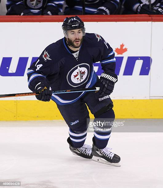 Anthony Peluso of the Winnipeg Jets skates down the ice during third period action in an NHL game against the Calgary Flames at the MTS Centre on...