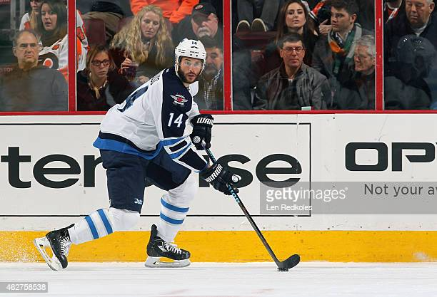 Anthony Peluso of the Winnipeg Jets skates the puck against the Philadelphia Flyers on January 29 2015 at the Wells Fargo Center in Philadelphia...