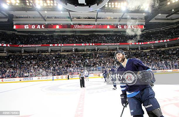 Anthony Peluso of the Winnipeg Jets skates to the bench after scoring a third period goal against the Toronto Maple Leafs at the MTS Centre on...