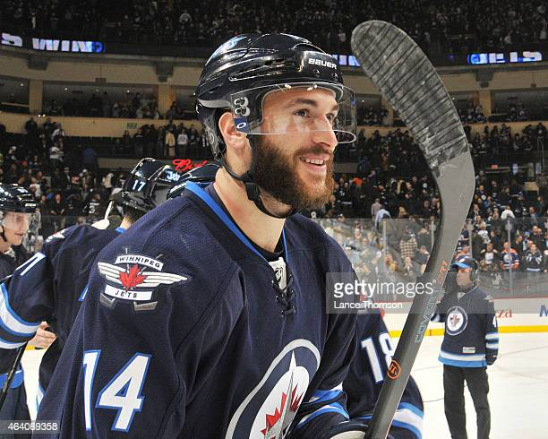 Anthony Peluso of the Winnipeg Jets smiles as he celebrates a 54 shootout victory over the Edmonton Oilers on February 16 2015 at the MTS Centre in...